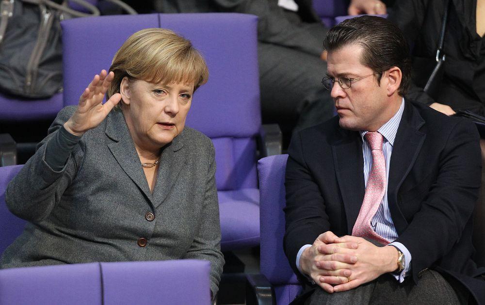 Angela Merkel und Karl-Theodor zu Guttenberg (Foto: picture alliance / dpa   Wolfgang Kumm)